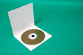 Cd on case photo of green background Royalty Free Stock Image