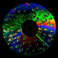 Cd disc with water drops dvd on black background Stock Images