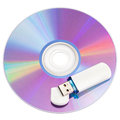 Cd disks and flash drive on white background Royalty Free Stock Photo