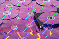 CD DVD Burner with Many Compact Discs Royalty Free Stock Photo