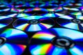 CDs / DVDs lying on a black background with colorful reflections of light. Royalty Free Stock Photo