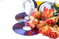 CDs, headphones and roses over white Royalty Free Stock Images