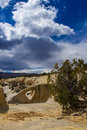 Cedar wash arch vertical composition of in grand staircase escalante national monument utah with stormy sky Royalty Free Stock Image