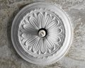 Ceiling stucco in the form of a flower on background cleared concrete Stock Image