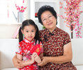 Celebrate chinese new year beautiful grandparent and grandchild at home Royalty Free Stock Photo