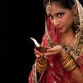 Celebrate diwali festive of lights beautiful indian girl hands holding diya oil lamp celebrating traditional sari prayer isolated Royalty Free Stock Photography