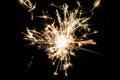 Celebrate party sparkler little fireworks on black background. Royalty Free Stock Photo