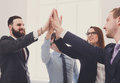 Celebrate success and win concept, give five in office, business people team