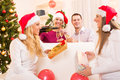 Celebrating christmas or new year happy friends with glass of champagne in home interior Stock Photo