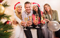 Celebrating christmas or new year happy friends with glass of champagne and toasting Royalty Free Stock Photography