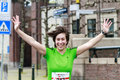Celebrating dordrecht the netherlands april female runner in green during the th edition of dwars door dordt a competition run of Stock Photography