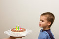 Celebrating fifth birthday boy cake happy childhood child Royalty Free Stock Photo