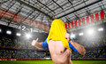 Celebrating a goal soccer or football player is on stadium with his jersey on head Royalty Free Stock Images