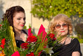 Celebrating granny and granddaughter portrait Royalty Free Stock Photo