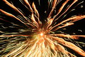 Celebrating happy new year with a blast and boom lightning fire effects through out the sky at night Stock Photos