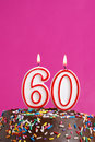 Celebrating sixty years a number candle is lit in celebration of Royalty Free Stock Images