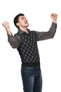Celebrating success young businessman with his arms raised in triumph over white Stock Images