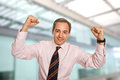 Celebrating successful business man with open arms as a winner Royalty Free Stock Images