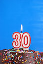 Celebrating thirty years a number candle is lit in celebration of Stock Photo