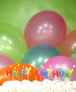 Celebration with balloons candles and cake happy birthday Royalty Free Stock Photography