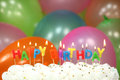 Celebration with balloons candles and cake happy birthday Stock Images