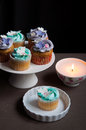 Celebration cupcakes on stand with candle elegant white fondant decorations Royalty Free Stock Photos
