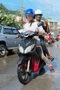 Celebration of songkran festival the thai new year on phuket thailand april two moped drive wet because by splashing water to Stock Image