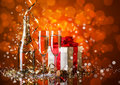Celebration still life with champagne on red sparkle blur background Royalty Free Stock Image