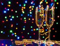 Celebration theme glasses of wine with blur light spots on background Stock Photos