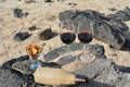 Celebration with two glasses of red wine on the nice tropical beach in canary islands spain Royalty Free Stock Photo