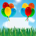 Celebratory background colorful balloons and paper against the sky and green grass Royalty Free Stock Photos