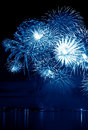 Celebratory blue firework in a night sky Stock Photography