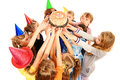 Celebratory cake group of happy kids celebrating birthday with a isolated over white Royalty Free Stock Photography