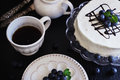 Celebratory cake with white frosting and fresh blueberries on a dark background festivals and events Royalty Free Stock Photos