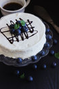 Celebratory cake with white frosting and fresh blueberries on a dark background festivals and events selective focus Royalty Free Stock Image