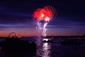 Celebratory firework bright in a night sky on the river Stock Images