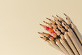 Celebratory pencil among usual pencils Royalty Free Stock Images