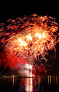 Celebratory red firework bright in a night sky Royalty Free Stock Photos