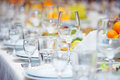 Celebratory served table big with glasses and plates Stock Images
