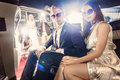 Celebrity couple in a limousine Royalty Free Stock Photo