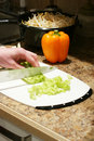 Celery being chopped Royalty Free Stock Image
