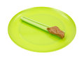 Celery stalk with peanut butter on green plate Royalty Free Stock Photography