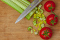 Celery and tomatoes on a cutting board Royalty Free Stock Photo