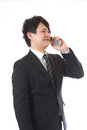 Cell-phone and businessman Royalty Free Stock Photography