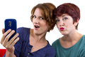 Cell phone pics two women taking self portraits with a Royalty Free Stock Images