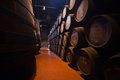 Cellar with wine barrels olden casks of different sizes hold port fortified to mature in cellars Royalty Free Stock Photography