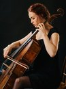Cellist and her old cello photo of a beautiful woman playing an Stock Image