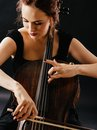 Cellist photo of a beautiful woman playing an old cello Royalty Free Stock Photography