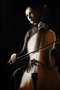 Cello cellist player classical musician isolated on black background Royalty Free Stock Images
