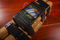 Cellphone conected to aexplosives laying on the ground Royalty Free Stock Photo